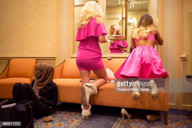 Hamdia Ahmed takes a moment to rest after putting on her makeup while Miss Teen USA contestants Rileigh Jones center and Adrianna Knight right finish...
