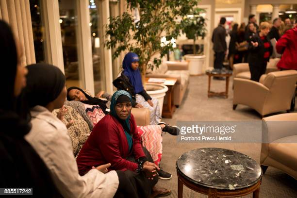 Hamdia Ahmed's mother Mumina Ali center waits in the lobby of the Holiday Inn with her daughter and four granddaughters before watching Ahmed compete...