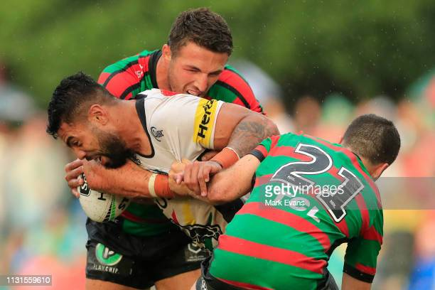 Hame Sele of the Panthers is tackled by Sam Burgess and Dean Hawkins of Souths during the NRL trial match between the South Sydney Rabbitohs and the...