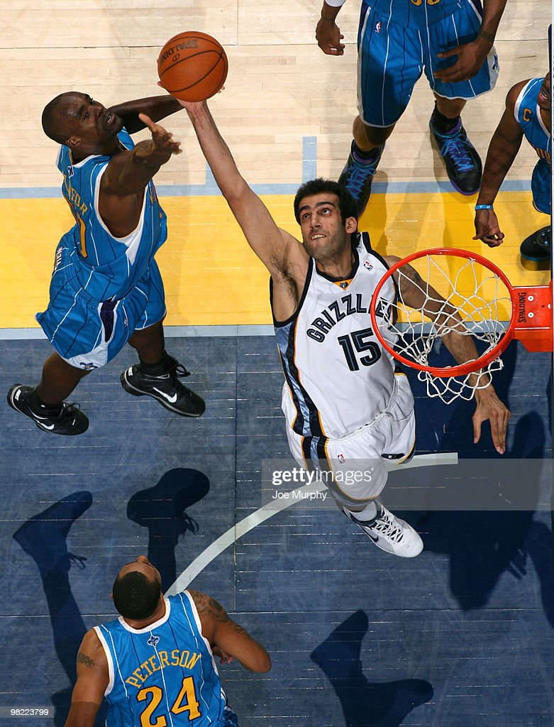 Hamed Haddadi #15 of the Memphis Grizzlies grabs a rebound against Emeka Okafor #50 of the New Orleans Hornets on April 02, 2010 at FedExForum in Memphis, Tennessee.