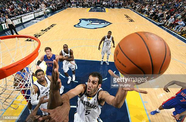 Hamed Haddadi of the Memphis Grizzlies shoots against Ben Wallace of the Detroit Pistons on March 3 2012 at FedExForum in Memphis Tennessee NOTE TO...