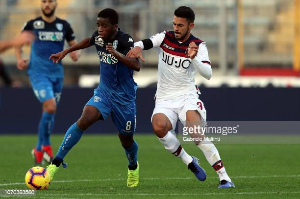 Hamed Junior Traore' of Empoli FC battles for the ball with Gianlcarlo Gonzalez of Bologna FC during the Serie A match between Empoli and Bologna FC...