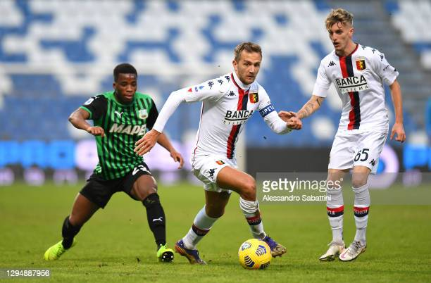 Hamed Junior Traore of Sassuolo battles for possession with Domenico Criscito of Genoa CFC during the Serie A match between US Sassuolo and Genoa CFC...