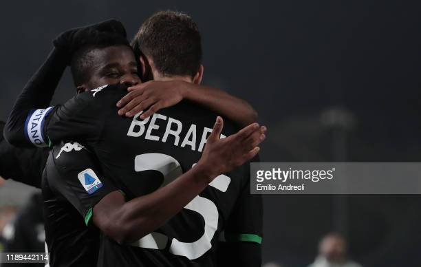 Hamed Junior Traore of US Sassuolo celebrates with his teammate Domenico Berardi after scoring the opening goal during the Serie A match between...