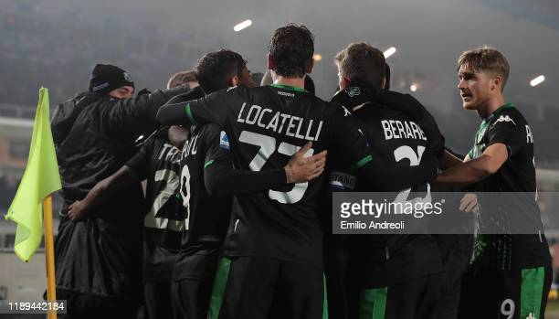Hamed Junior Traore of US Sassuolo celebrates with his teammates after scoring the opening goal during the Serie A match between Brescia Calcio and...