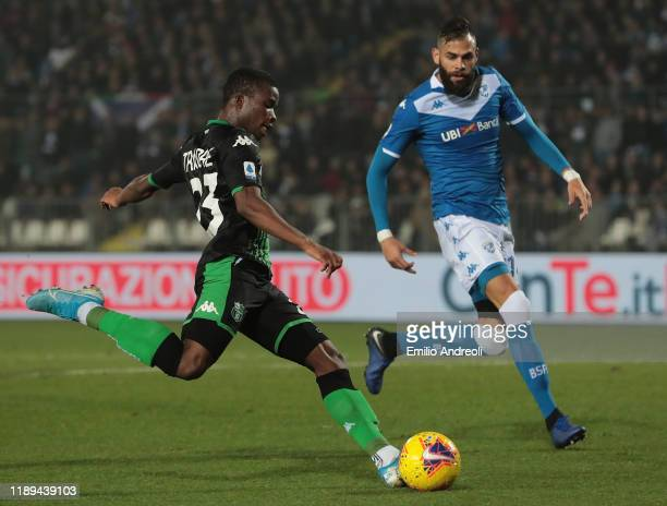 Hamed Junior Traore of US Sassuolo scores the opening goal during the Serie A match between Brescia Calcio and US Sassuolo at Stadio Mario Rigamonti...
