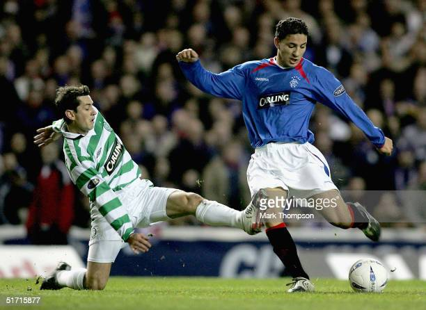 Hamed Namouchi of Rangers is tackled by Jackie MacNamara of Celtic during the CIS Insurance Cup fourth round between Celtic and Rangers at Ibrox on...