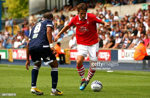 Hamer Bouazza of Millwall in action with Chris Cohen of Nottingham Forest