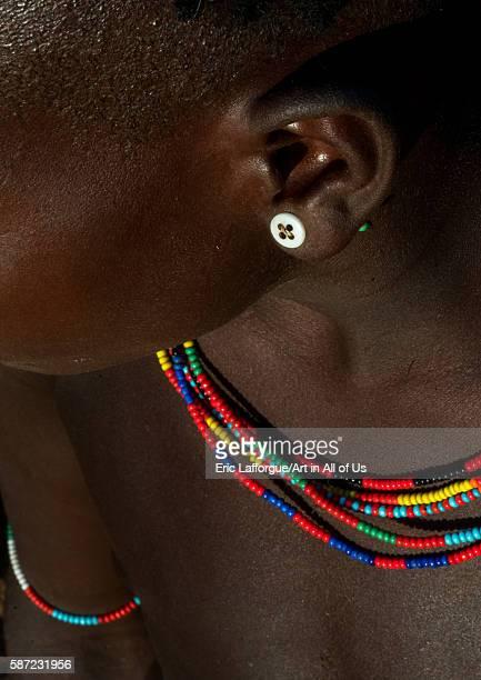 Hamer tribe girl with a button used as earring omo valley turmi Ethiopia on March 13 2016 in Turmi Ethiopia