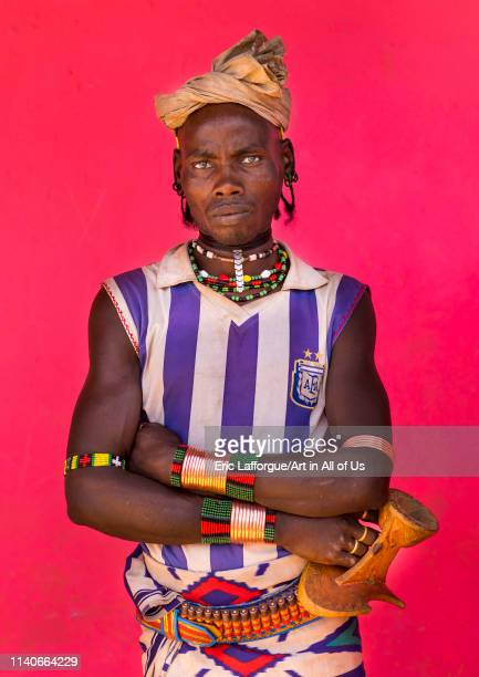 Hamer tribe man with an argentina football shirt Dimeka market Omo valley Ethiopia on December 28 2013 in Dimeka Ethiopia