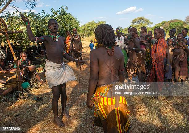 Hamer tribe maze whipping a woman during a bull jumping ceremony omo valley turmi Ethiopia on March 12 2016 in Turmi Ethiopia