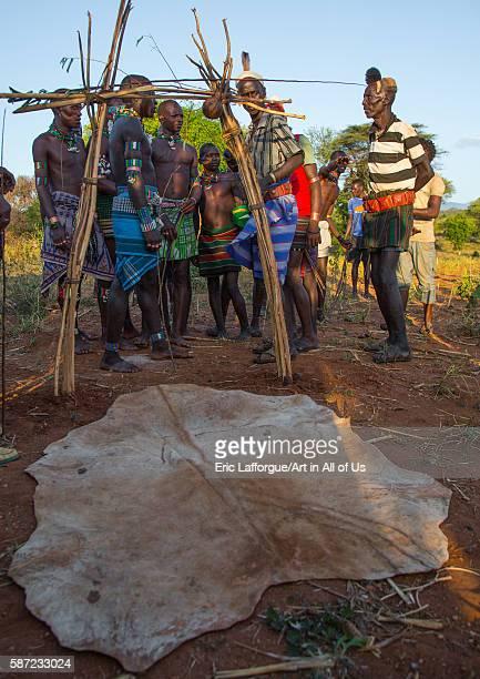 Hamer tribe men passing thru a symbolic door during a bull jumping ceremony omo valley turmi Ethiopia on March 12 2016 in Turmi Ethiopia