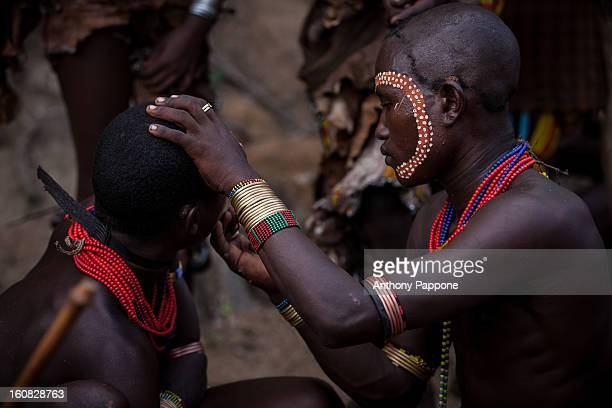 Hamer tribe paint their faces during the ceremony bull jumping. Bull jumping ceremony is a rite of passage ceremony for men coming of age must be...