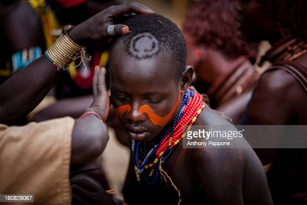 CONTENT] hamer tribe paint their faces during the ceremony bull jumping Bull jumping ceremony is a rite of passage ceremony for men coming of age...