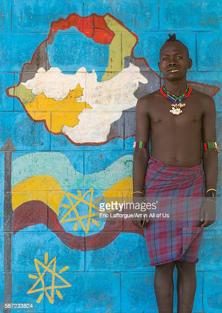 Hamer tribe teenager in a school in front of a painted wall with the ethiopian map omo valley turmi Ethiopia on March 16 2016 in Turmi Ethiopia