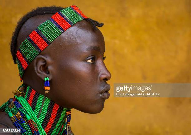 Hamer tribe woman with beaded necklace and headwear Omo valley Dimeka Ethiopia on June 10 2017 in Dimeka Ethiopia