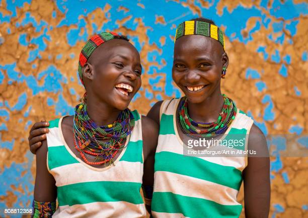 Hamer tribe young women laughing Omo valley Dimeka Ethiopia on June 10 2017 in Dimeka Ethiopia