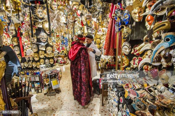 Hamid a traditional artisan who specilises in costumes and masks works at Ca' Del Sol on February 7 2017 in Venice Italy Artisans masks and costume...