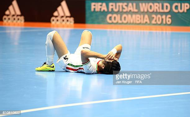 Hamid Ahmadi of Iran lies on the ground dejected after the final whistle during the FIFA Futsal World Cup semifinal match between Iran and Russia at...