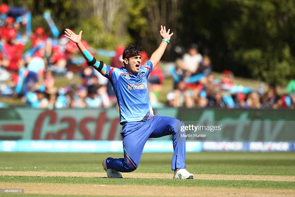 Hamid Hassan of Afghanistan celebrates dismissing Hamish Gardiner of Scotland during the 2015 ICC Cricket World Cup match between Afghanistan and Scotland at University Oval on February 26, 2015 in Dunedin, New Zealand.