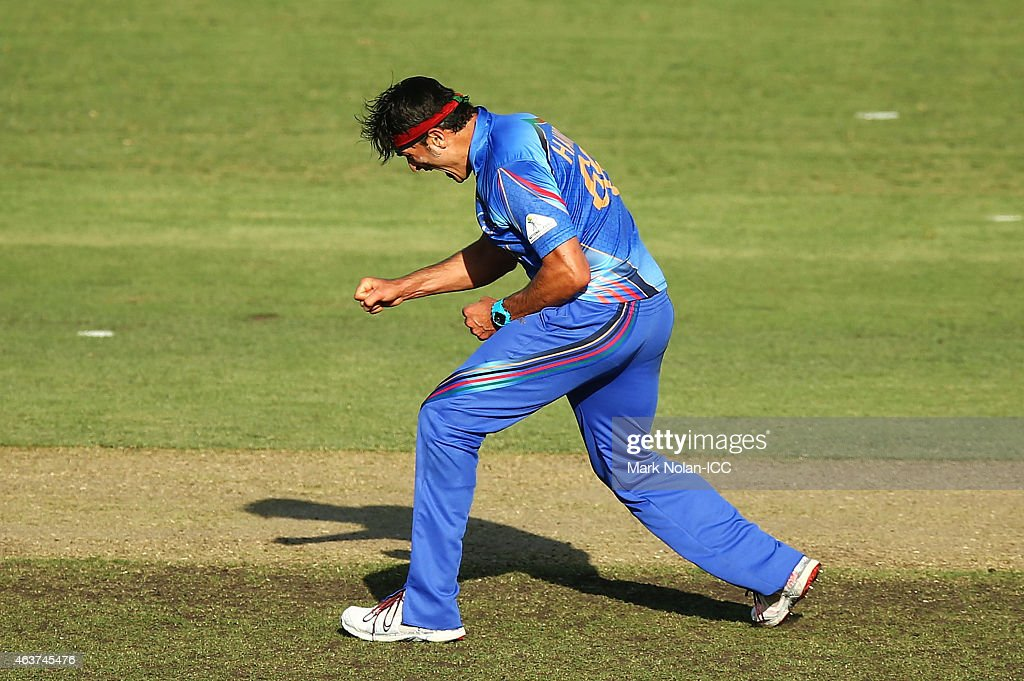 Hamid Hassan of Afghanistan celebrates getting the wicket of Shabbir Rahman of Bangladesh during the 2015 ICC Cricket World Cup match between Bangladesh and Afghanistan at Manuka Oval on February 18, 2015 in Canberra, Australia.