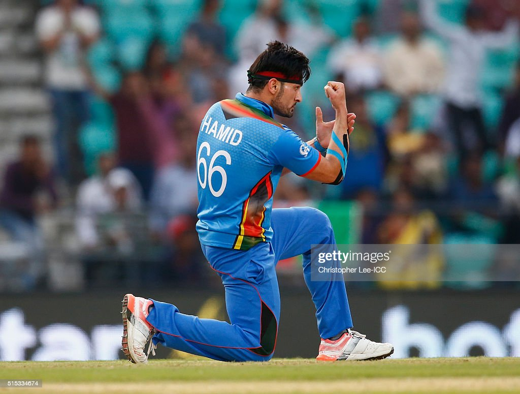Hamid Hassan of Afghanistan celebrates taking the wicket of Hamilton Masakadza, Captain of Zimbabwe during the ICC Twenty20 World Cup Round 1 Group B match between Zimbabwe and Afghanistan at the Vidarbha Cricket Association Stadium on March 12, 2016 in Nagpur, India.