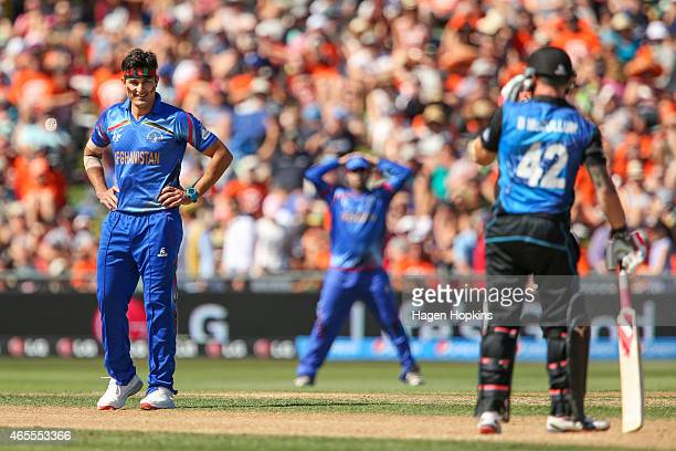 Hamid Hassan of Afghanistan reacts after bowling a delivery to Brendon McCullum of New Zealand during the 2015 ICC Cricket World Cup match between...