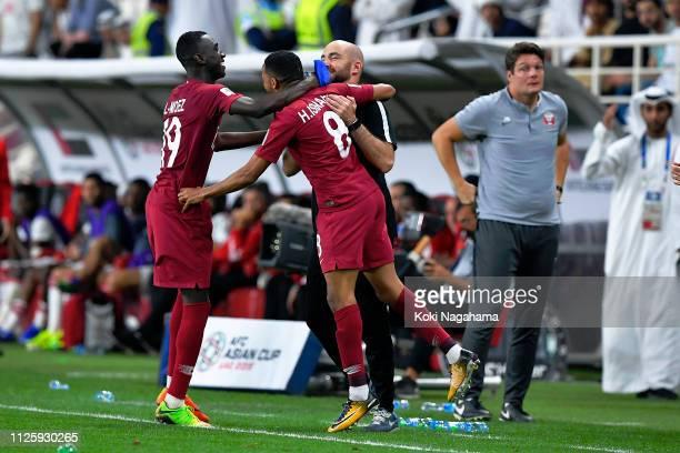 Hamid Ismaeil Khaleefa of Qatar celebrates scoring their fourth goal with Manager Felix Sanchez Bas during the AFC Asian Cup semi final match between...