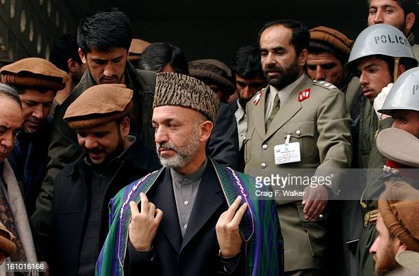 Hamid Karzai the Chairman of the Executive Council of Afghanistan exits the Interior Ministry building after taking an oath of office during a...