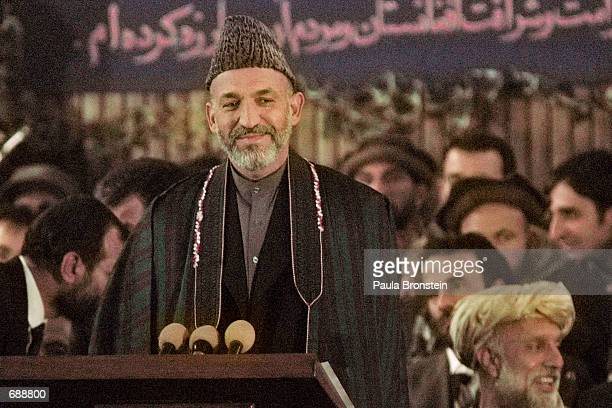 Hamid Karzai the new Prime Minister of Afghanistans new interim government smiles during his swearing in ceremony at the Interior Ministry December...