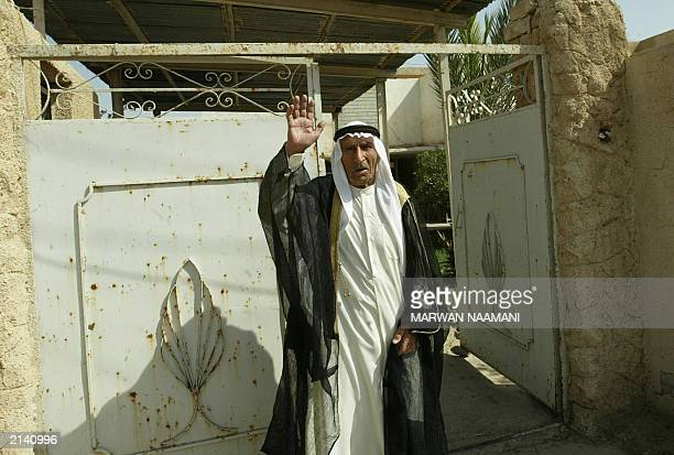 Hamid the 80yearold father of Abid Hamid Mahmud the most trusted lieutenant of toppled leader Saddam Hussein waves 19 June 2003 outside his home in...