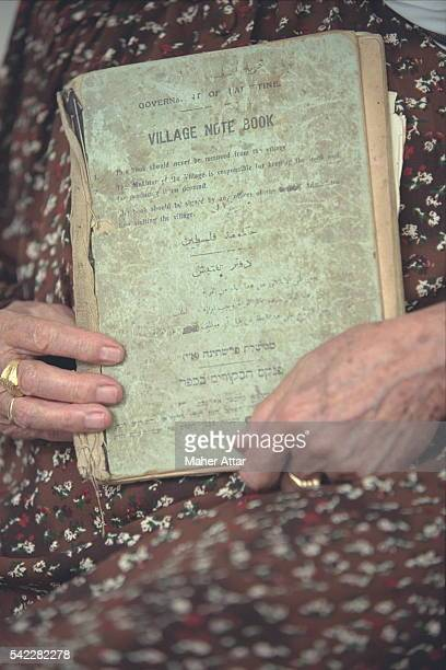 Hamida Rifai has kept the 'village book' in which her husband the mayor scrupulously recorded all events in the commune