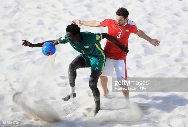 Hamidou Barry of Senegal and Kaspar Jaeggy of Switzerland challenge for the ball during the FIFA Beach Soccer World Cup Bahamas 2017 group A match...