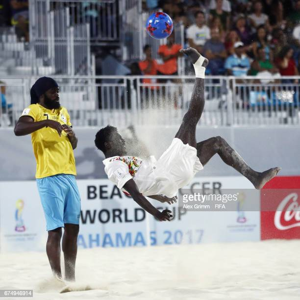 Hamidou Barry of Senegal attempts a bicycle kick next to Nesly Jean of Bahamas during the FIFA Beach Soccer World Cup Bahamas 2017 group A match...