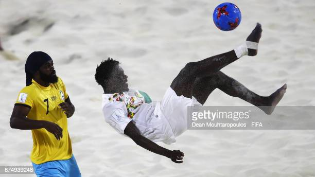 Hamidou Barry of Senegal attempts a scissor or bicycle kick shot on goal in front of Nesly Jean of Bahamas during the FIFA Beach Soccer World Cup...