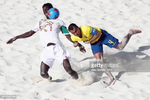 Hamidou Barry of Senegal is challenged by Mario Alava of Ecuador during the FIFA Beach Soccer World Cup Bahamas 2017 group A match between Ecuador...