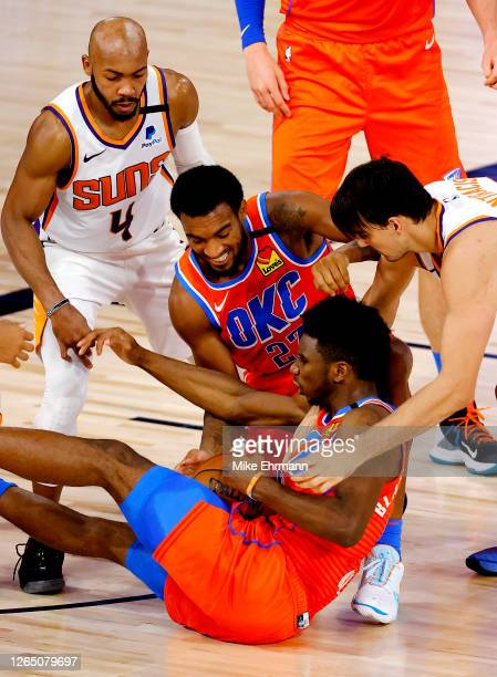 Hamidou Diallo and Terrance Ferguson of the Oklahoma City Thunder fight for a loose ball against Jevon Carter and Dario Saric of the Phoenix Suns...