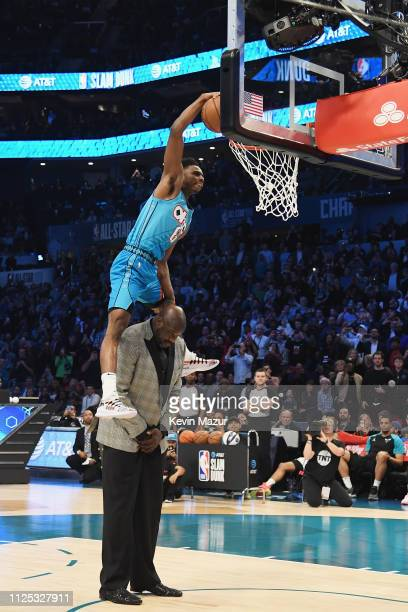 Hamidou Diallo jumps over Shaquille O'Neal to shoot the ball at the ATT Slam Dunk during the 2019 State Farm AllStar Saturday Night at Spectrum...