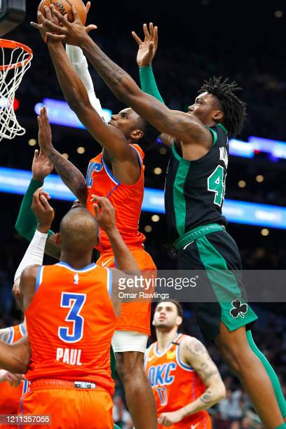 Hamidou Diallo of the Oklahoma City Thunder and Robert Williams III of the Boston Celtics compete for a rebound during the fourth quarter of the game...