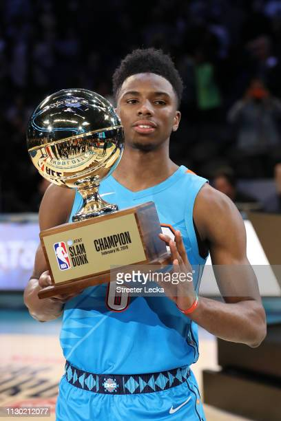 Hamidou Diallo of the Oklahoma City Thunder celebrates with the trophy after winning the ATT Slam Dunk as part of the 2019 NBA AllStar Weekend at...