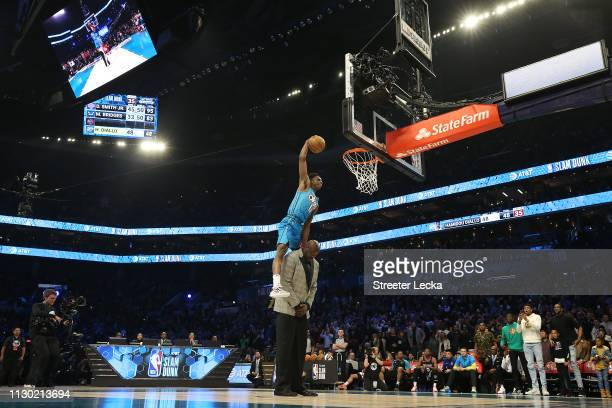 Hamidou Diallo of the Oklahoma City Thunder dunks over Shaquille O'Neal during the ATT Slam Dunk as part of the 2019 NBA AllStar Weekend at Spectrum...