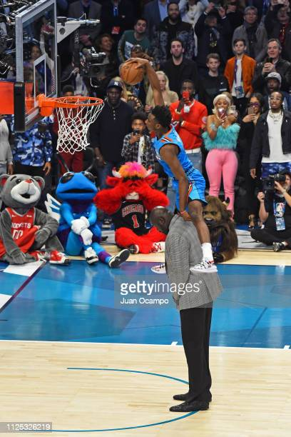 Hamidou Diallo of the Oklahoma City Thunder dunks the ball over Shaquille O'Neal during the 2019 ATT Slam Dunk Conest on February 16 2019 at the...