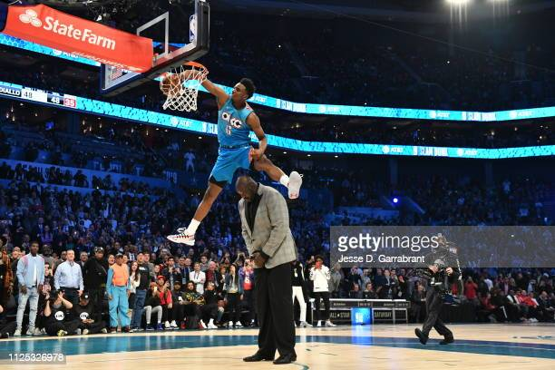 Hamidou Diallo of the Oklahoma City Thunder dunks the ball over Shaquille O'Neal during the 2019 ATT Slam Dunk Contest during the 2019 ATT Slam Dunk...