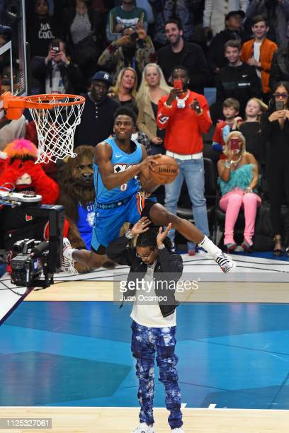 Hamidou Diallo of the Oklahoma City Thunder dunks the ball over Rapper Quavo during the ATT Slam Dunk Contest as part of NBA AllStar State Farm...