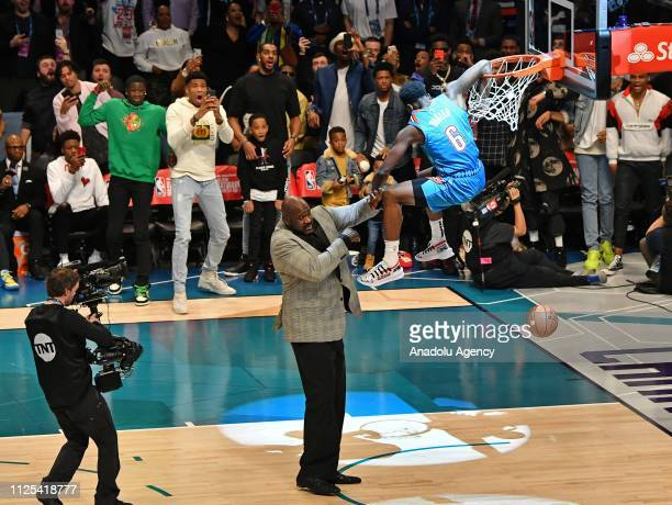 Hamidou Diallo of the Oklahoma City Thunder dunks the ball over Shaquille O'Neal during the 2019 AT&T Slam Dunk Contest as part of the State Farm...