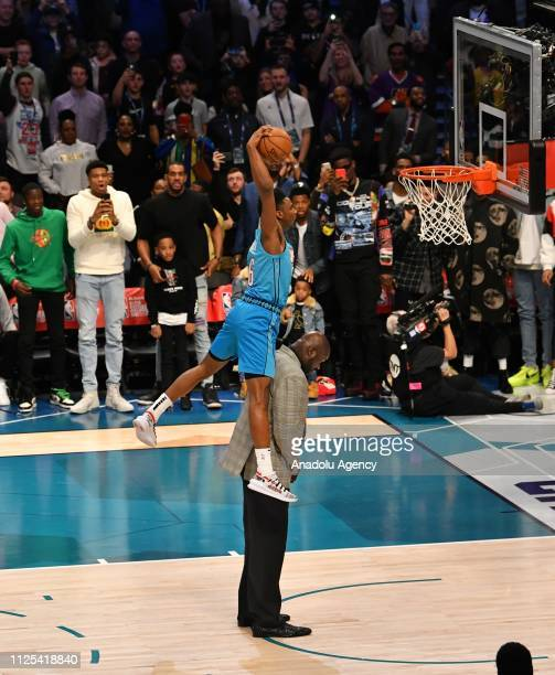 Hamidou Diallo of the Oklahoma City Thunder dunks the ball over Shaquille O'Neal during the 2019 ATT Slam Dunk Contest as part of the State Farm...