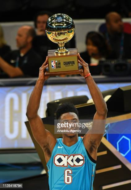 Hamidou Diallo of the Oklahoma City Thunder poses with the Champion trophy after winning the 2019 ATT Slam Dunk Contest as part of the State Farm...