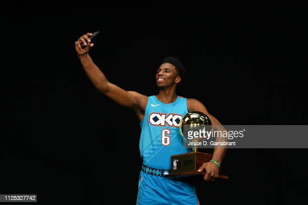 Hamidou Diallo of the Oklahoma City Thunder takes a selfie with the Champion trophy after winning the 2019 ATT Slam Dunk Contest as part of the State...