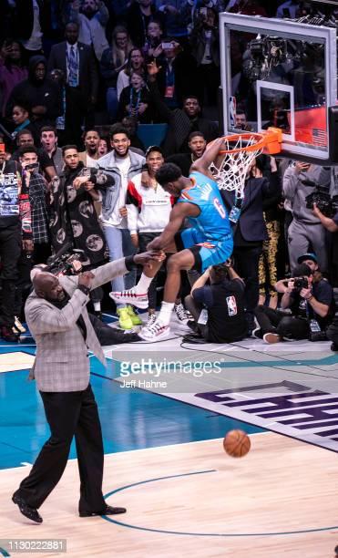 Hamidou Diallo slams a dunk over Shaquille O'Neal at the 2019 NBA AllStar Saturday Night on February 16 2019 in Charlotte North Carolina
