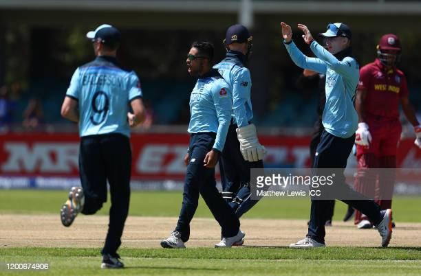 Hamidullah Qadri of England celebrates the wicket of Kimani Melius of West Indies during the ICC U19 Cricket World Cup Group B match between England...